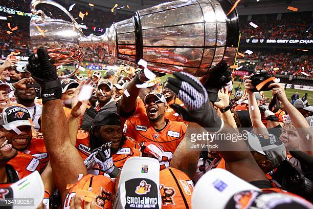 C Lions' players celebrate with the Grey Cup Grey Cup after beating the Winnipeg Blue Bombers 3423 to win the CFL 99th Grey Cup November 27 2011 at...