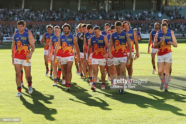 Lions players come from the field after the round 4 AFL game between Port Adelaide and the Brisbane Lions at Adelaide Oval on April 12 2014 in...