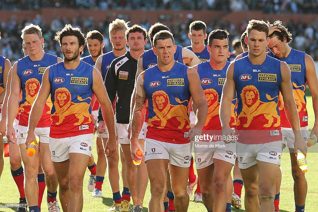 Lions players come from the field after the round 4 AFL game between Port Adelaide and the Brisbane Lions at Adelaide Oval on April 12, 2014 in Adelaide, Australia.