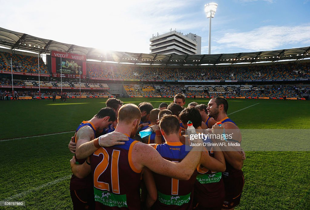 Lions players form a huddle after their defeat during the round six AFL match between the Brisbane Lions and the Sydney Swans at The Gabba on May 1, 2016 in Brisbane, Australia.
