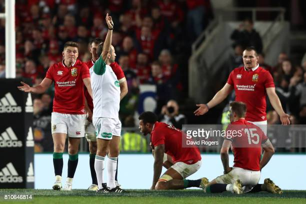 Lions players remonstrate with Referee Romain Poite of France after awarding a last minute scrum to the All Blacks during the third test match...