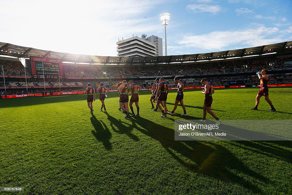 Lions players walk off after the round six AFL match between the Brisbane Lions and the Sydney Swans at The Gabba on May 1, 2016 in Brisbane, Australia.