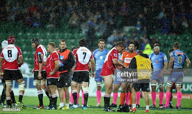 Lions prop Ruan Dreyer has a change of shorts in heavy rain during the Super 15 Rugby Union match against the Western Force in Perth on May 24 2014...