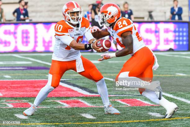 Lions quarterback Jonathon Jennings handing the ball to BC Lions running back Jeremiah Johnson during the BC Lions versus the Montreal Alouettes game...