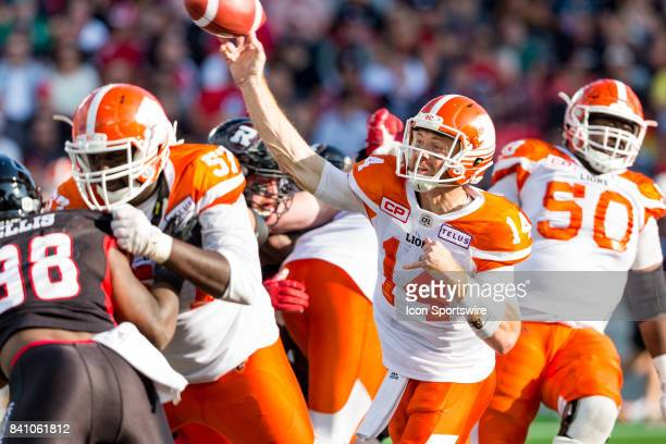 Lions quarterback Travis Lulay releases a pass during Canadian Football League action between BC Lions and Ottawa RedBlacks on August 26 2017 at TD...
