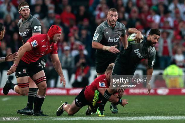 Lions Ruan Dreyer tackles Crusaders Richie Mo'unga during the Super XV rugby final match between Lions and Crusaders at Ellis Park Rugby stadium on...