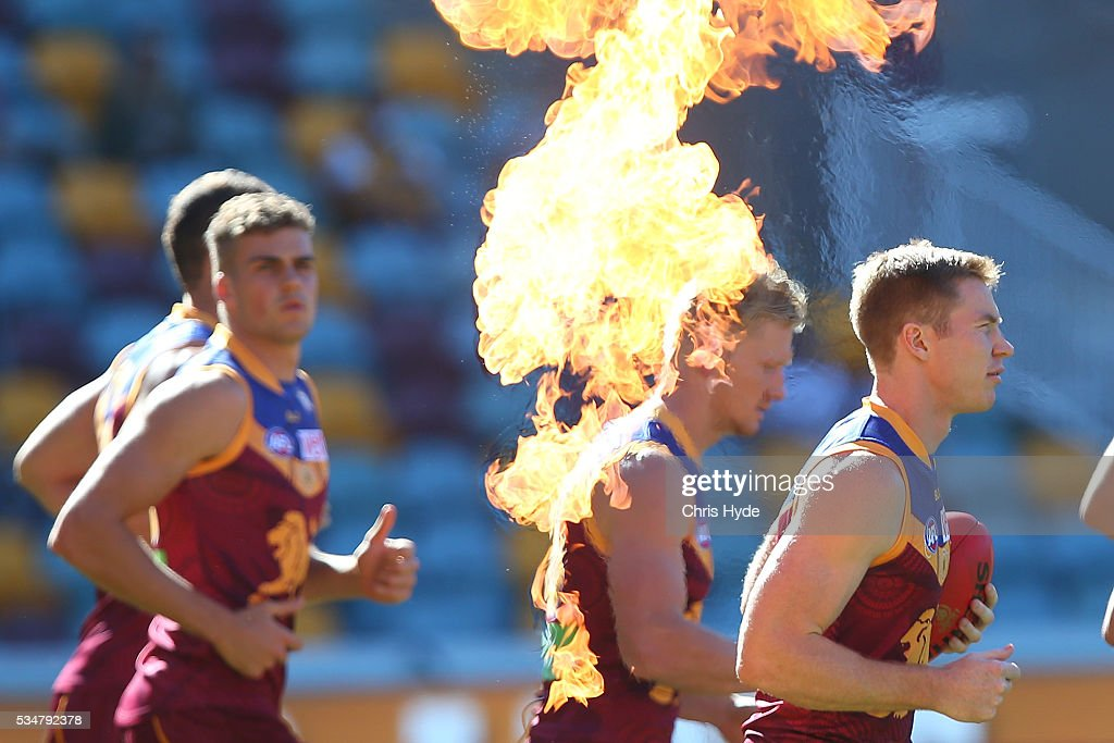 Lions runn out for the start of the round 10 AFL match between the Brisbane Lions and the Hawthorn Hawks at The Gabba on May 28, 2016 in Brisbane, Australia.