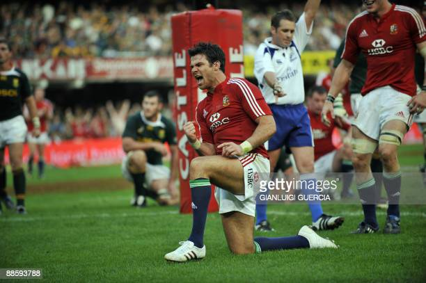 Lions scrumhalf Mike Phillips celebrates after scoring a try on June 20 2009 during the first test match between South African Springbok and the...