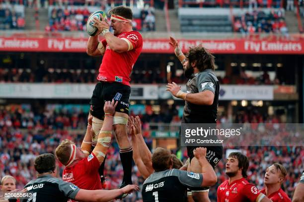 Lions' South African Jaco Kriel catches a ball in a lineup during the Super XV rugby final match between Lions and Crusaders at the Ellis Park Rugby...