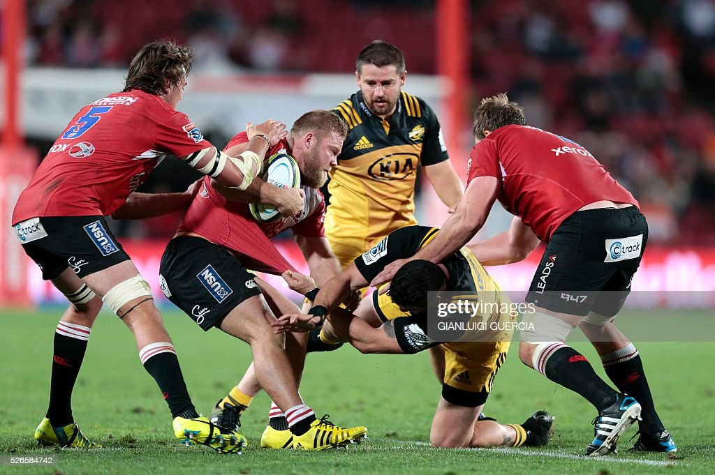 Lions South African prop Armand van der Merwe (2nd L) is tackled by Hurricanes New Zealand prop Jeffery Toomaga-Allen (2nd R) during the Super Rugby clash between Lions and Hurricanes at Ellis Park rugby stadium on April 30, 2016 in Johannesburg, South Africa. / AFP / GIANLUIGI