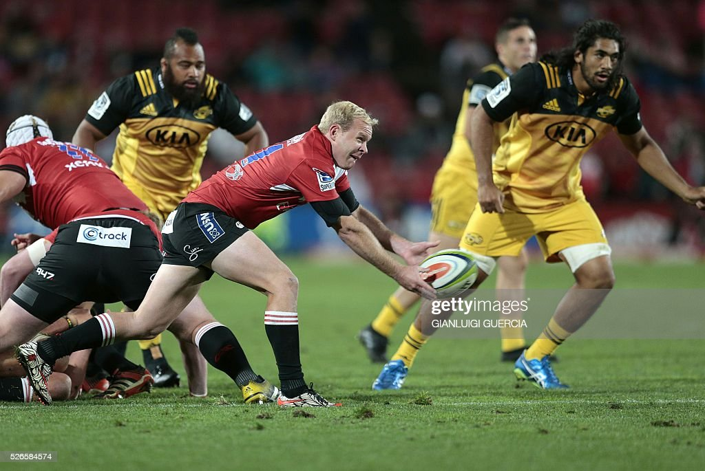Lions South African scrum-half Ross Cronje (C) clears the ball during the Super Rugby clash between Lions and Hurricanes at Ellis Park rugby stadium on April 30, 2016 in Johannesburg, South Africa. / AFP / GIANLUIGI