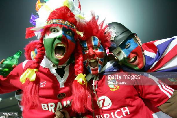 Lions supporters cheer during the match between the British and Irish Lions and the New Zealand Maori at Waikato Stadium June 11 2005 in Hamilton New...