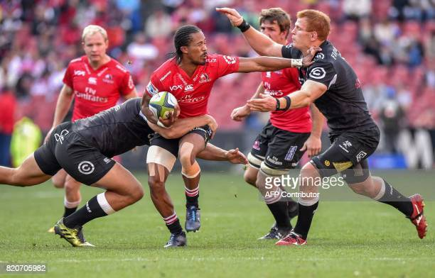Lions' Sylvian Mahuza is tackled by Sharks' Phillip van der Walt during the Super Rugby quarterfinal match between Lions and Sharks at the Ellis Park...