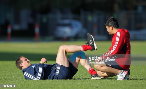 Lions tour captain Sam Warburton receives attention to his injured left leg from physiotherapist Prav Mathema during the British and Irish Lions...