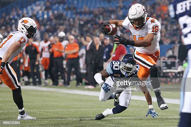 Lions wide receiver Bryan Burnham breaks away from Travis Hawkins to score a touchdown as the Toronto Argonauts lose to the BC Lions 2725 in Toronto...