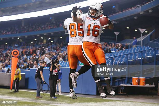 Lions wide receiver Bryan Burnham celebrates with Shawn Gore after scoring a touchdown as the Toronto Argonauts lose to the BC Lions 2725 in Toronto...