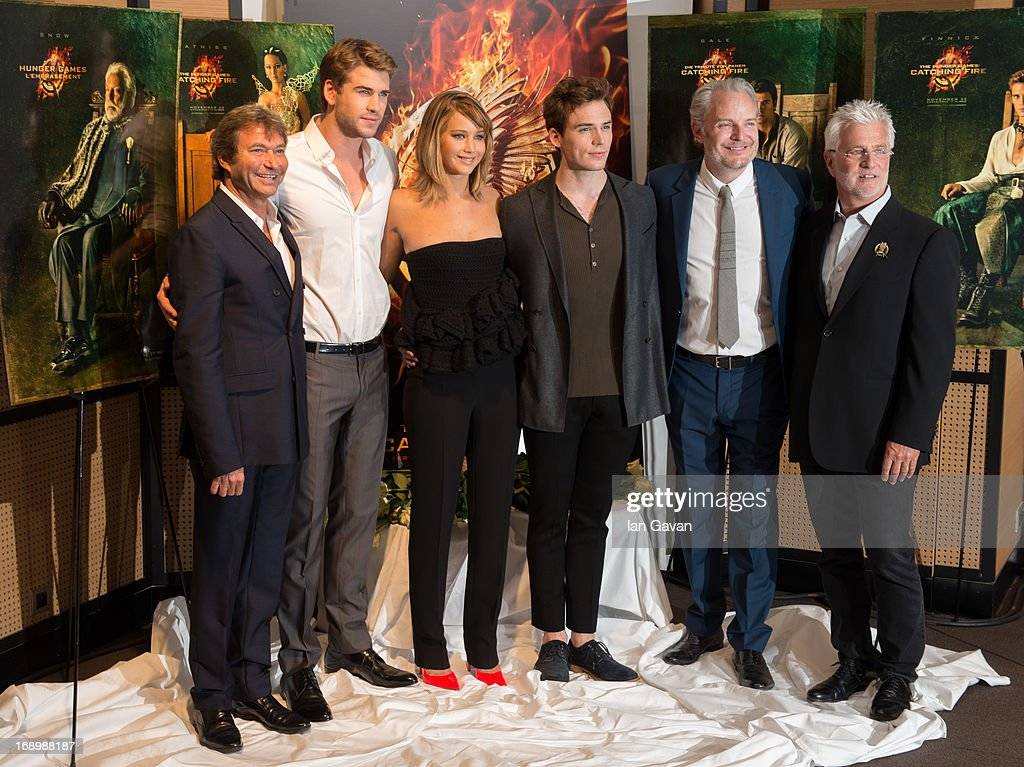 Lionsgate Films Co-Chairman Patrick Wachsberger, actor <a gi-track='captionPersonalityLinkClicked' href=/galleries/search?phrase=Liam+Hemsworth&family=editorial&specificpeople=6338547 ng-click='$event.stopPropagation()'>Liam Hemsworth</a>, actress <a gi-track='captionPersonalityLinkClicked' href=/galleries/search?phrase=Jennifer+Lawrence&family=editorial&specificpeople=1596040 ng-click='$event.stopPropagation()'>Jennifer Lawrence</a>, actor <a gi-track='captionPersonalityLinkClicked' href=/galleries/search?phrase=Sam+Claflin&family=editorial&specificpeople=7238693 ng-click='$event.stopPropagation()'>Sam Claflin</a> and director <a gi-track='captionPersonalityLinkClicked' href=/galleries/search?phrase=Francis+Lawrence&family=editorial&specificpeople=224820 ng-click='$event.stopPropagation()'>Francis Lawrence</a> and Lionsgate Films Co-Chairman <a gi-track='captionPersonalityLinkClicked' href=/galleries/search?phrase=Rob+Friedman&family=editorial&specificpeople=234962 ng-click='$event.stopPropagation()'>Rob Friedman</a> pose at the 'The Hunger Games: Catching Fire' photocall during The 66th Annual Cannes Film Festival at Nespresso Beach on May 18, 2013 in Cannes, France.