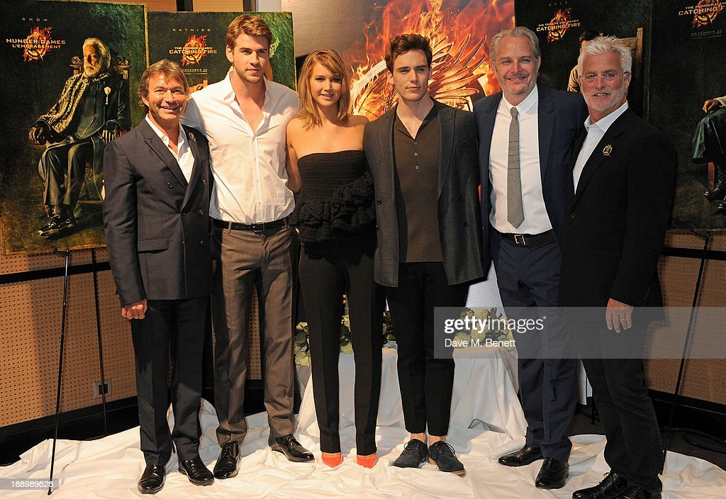 Lionsgate Motion Picture Group Co-Chairman Patrick Wachsberger, actors <a gi-track='captionPersonalityLinkClicked' href=/galleries/search?phrase=Liam+Hemsworth&family=editorial&specificpeople=6338547 ng-click='$event.stopPropagation()'>Liam Hemsworth</a>, <a gi-track='captionPersonalityLinkClicked' href=/galleries/search?phrase=Jennifer+Lawrence&family=editorial&specificpeople=1596040 ng-click='$event.stopPropagation()'>Jennifer Lawrence</a> and <a gi-track='captionPersonalityLinkClicked' href=/galleries/search?phrase=Sam+Claflin&family=editorial&specificpeople=7238693 ng-click='$event.stopPropagation()'>Sam Claflin</a>, director <a gi-track='captionPersonalityLinkClicked' href=/galleries/search?phrase=Francis+Lawrence&family=editorial&specificpeople=224820 ng-click='$event.stopPropagation()'>Francis Lawrence</a>, and Lionsgate Motion Picture Group Co-Chairman <a gi-track='captionPersonalityLinkClicked' href=/galleries/search?phrase=Rob+Friedman&family=editorial&specificpeople=234962 ng-click='$event.stopPropagation()'>Rob Friedman</a> attend The Hunger Games: Catching Fire photocall at the 2013 Cannes Film Festival at Majestic Barierre on May 18, 2013 in Cannes, France.