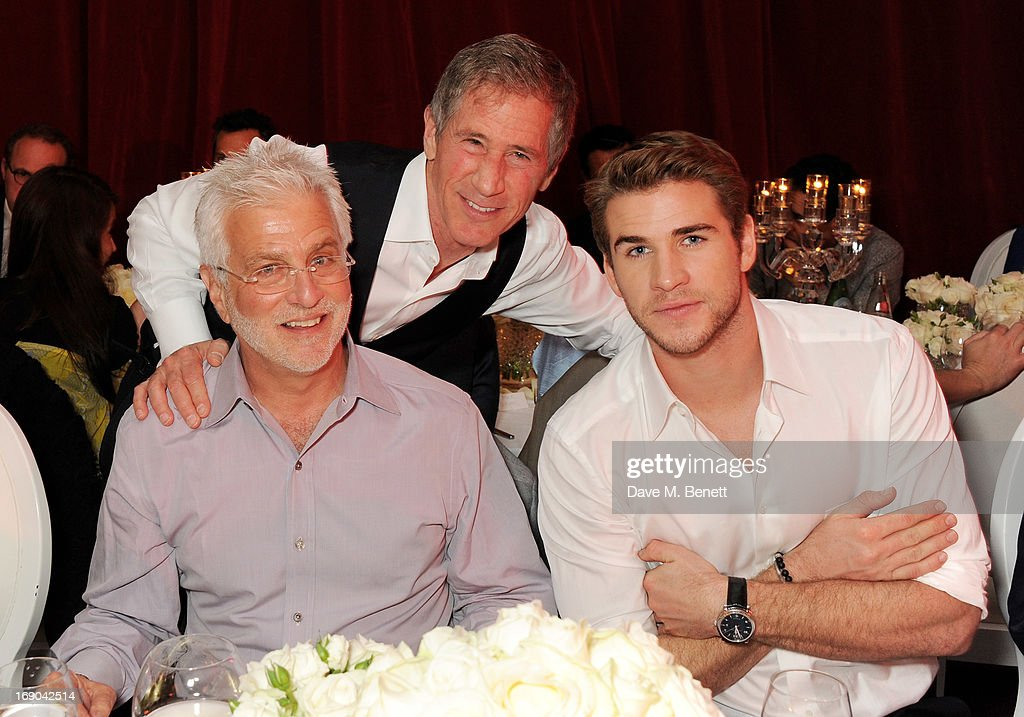 Lionsgate Motion Picture Group Co-Chairman <a gi-track='captionPersonalityLinkClicked' href=/galleries/search?phrase=Rob+Friedman&family=editorial&specificpeople=234962 ng-click='$event.stopPropagation()'>Rob Friedman</a>, <a gi-track='captionPersonalityLinkClicked' href=/galleries/search?phrase=Jon+Feltheimer&family=editorial&specificpeople=677969 ng-click='$event.stopPropagation()'>Jon Feltheimer</a> and actor <a gi-track='captionPersonalityLinkClicked' href=/galleries/search?phrase=Liam+Hemsworth&family=editorial&specificpeople=6338547 ng-click='$event.stopPropagation()'>Liam Hemsworth</a> attend Lionsgate's The Hunger Games: Catching Fire Cannes Party at Baoli Beach sponsored by COVERGIRL on May 18, 2013 in Cannes, France.