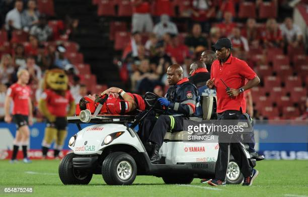 Lions's Johannes Jonker leaves the field on a stretcher after being injured during the Super XV rugby match between Lions and Reds at Ellis Park...