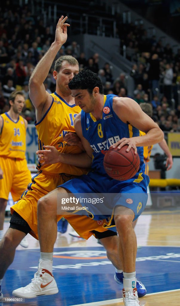Lior Eliyahu, #8 of Maccabi Electra Tel Aviv competes with Sergey Monya, #12 of BC Khimki Moscow Region in action during the 2012-2013 Turkish Airlines Euroleague Top 16 Date 4 between BC Khimki Moscow Region v Maccabi Electra Tel Aviv at Basketball Center of Moscow Region on January 18, 2013 in Moscow, Russia.