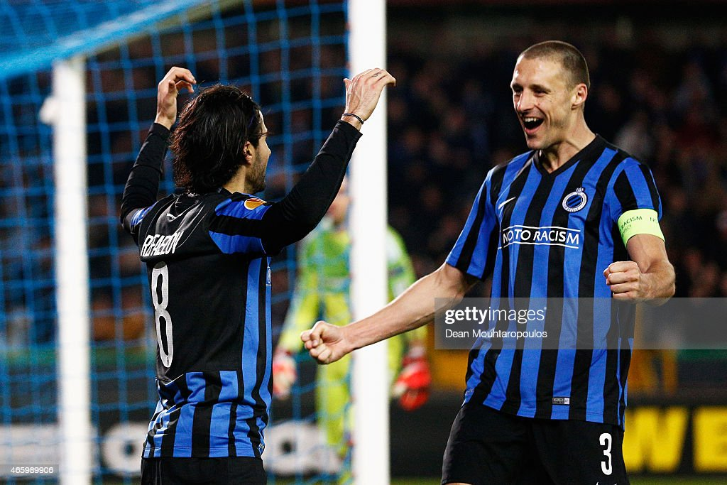 Lior Rafaelov of Club Brugge celebrates scoring his penalty and teams second goal of the game with <a gi-track='captionPersonalityLinkClicked' href=/galleries/search?phrase=Timmy+Simons&family=editorial&specificpeople=794114 ng-click='$event.stopPropagation()'>Timmy Simons</a> during the UEFA Europa League Round of 16 1st leg match between Club Brugge KV and Besiktas JK held at the Jan Breydel Stadium on March 12, 2015 in Brugge, Belgium.