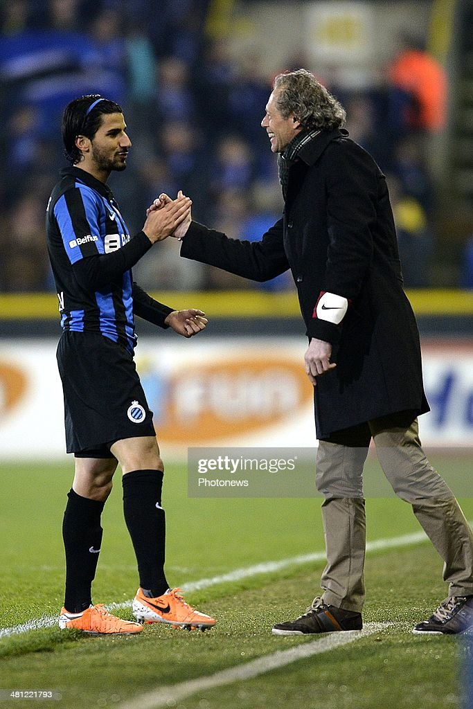 Lior Refaelov of Club Brugge celebrates scoring the opening goal with head coach <a gi-track='captionPersonalityLinkClicked' href=/galleries/search?phrase=Michel+Preud%27homme&family=editorial&specificpeople=2514028 ng-click='$event.stopPropagation()'>Michel Preud'homme</a> of Club Brugge during the Jupiler Pro League Play-Off 1 match between Club Brugge and Sporting Lokeren on March 28, 2014 in the Jan Breydel Stadium in Brugge, Belgium.