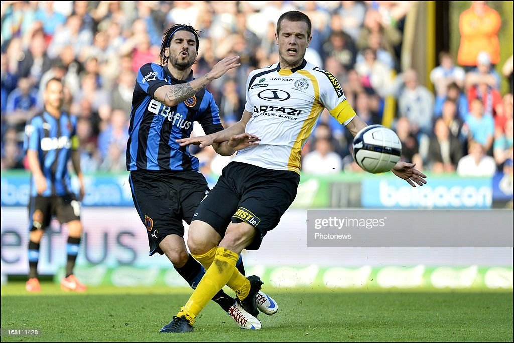 Lior Refaelov of Club Brugge KV (L) battles for the ball with Killian Overmeire of Sporting Lokeren OVL during the Jupiler Pro League play-off 1 match between Club Brugge and Sporting Lokeren on May 5, 2013 in Brugge, Belgium.