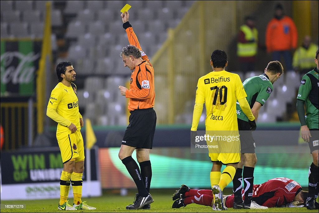 Lior Refaelov (L) of Club Brugge KV is shown a yellow card by referee Van De Velde for a foul on Coppens Jo of Cercle Brugge during the Jupiler League match between Cercle Brugge and Club Brugge on February 28, 2013 in Brugge, Belgium.