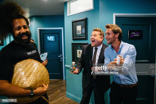 Lior Suchard demonstrates a guessing game with Reggie Watts and James Corden in the green room during 'The Late Late Show with James Corden' Monday...