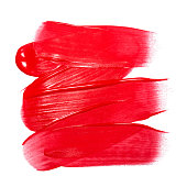 Lip gloss sample isolated on white. Smudged red lipgloss. Makeup product sample.