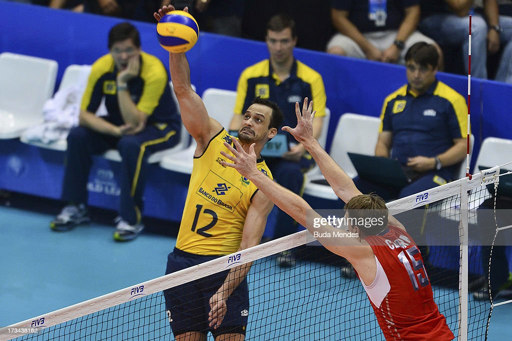 Lipe (L) of Brazil in action against Clark of USA during a match between Brazil and USA as part of the FIVB Volleyball World League 2013 at the Maracanazinho gymnasium on July 14, 2013 in Rio de Janeiro, Brazil.