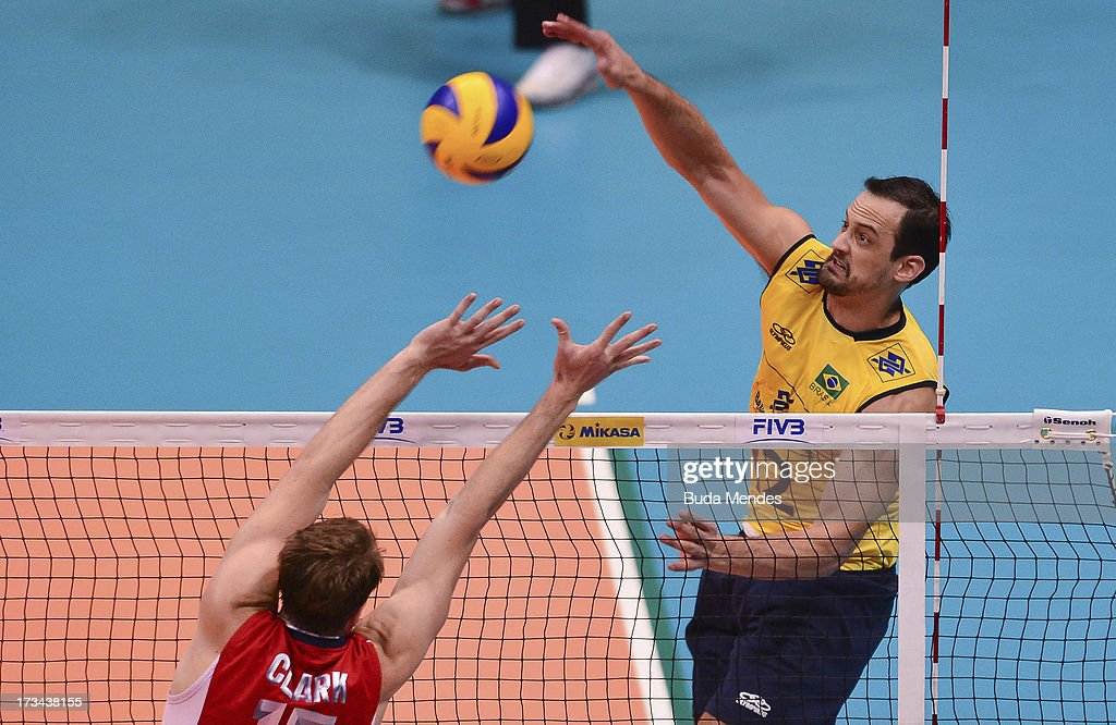 Lipe (R) of Brazil in action against USA during a match between Brazil and USA as part of the FIVB Volleyball World League 2013 at the Maracanazinho gymnasium on July 14, 2013 in Rio de Janeiro, Brazil.
