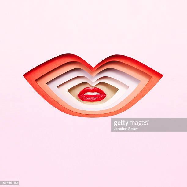 Lips through cardboard cutout