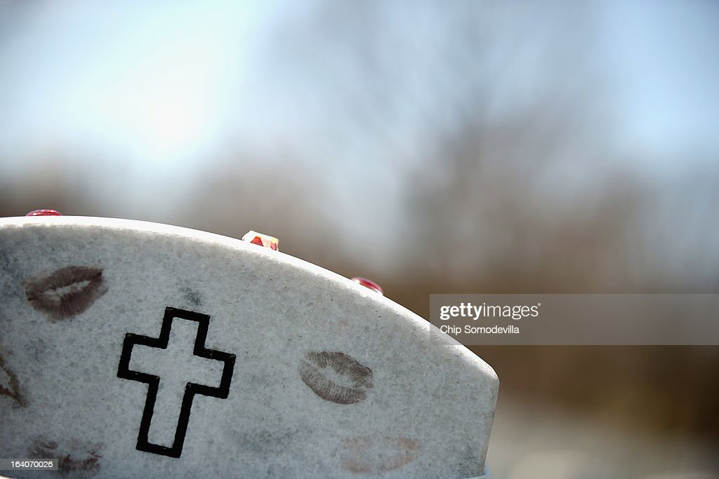 Lipstick kisses mark a headstone for an Afghanistan war casualty on the 10th anniversary of the beginning of the war in Iraq at Arlington National Cemetery March 19, 2013 in Arlington, Virginia. The bombing of Baghdad began on March 19, 2003.