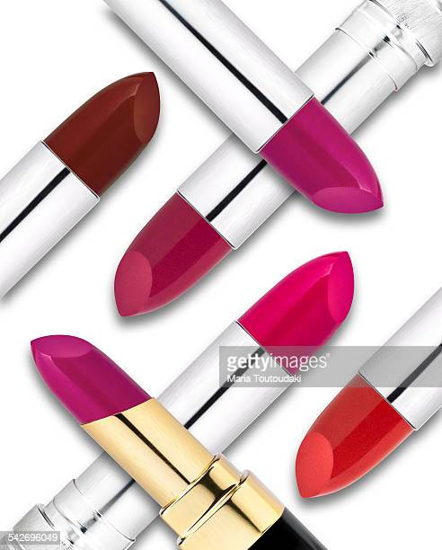 Lipsticks on a heap, on white background