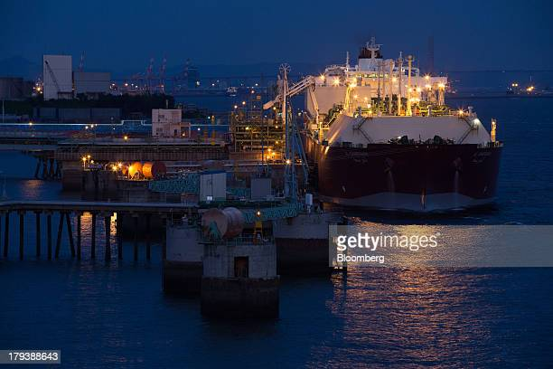 Liquefied natural gas is unloaded via pipes from the Al Kharsaah LNG tanker docked at the Korea Gas Corp LNG terminal at night in Pyeongtaek South...