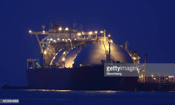 A liquefied natural gas tanker is berthed at Tokyo Electric Power Co's Futtsu gasfired thermal power plant at night in Futtsu Chiba Prefecture Japan...