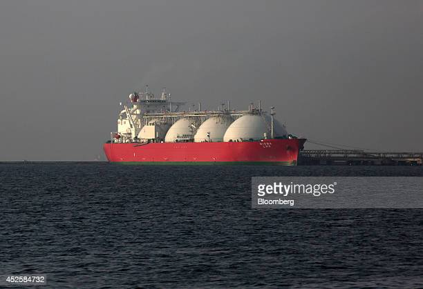 A liquefied natural gas tanker is berthed at Tokyo Electric Power Co's Futtsu gasfired thermal power plant in Futtsu Chiba Prefecture Japan on Monday...