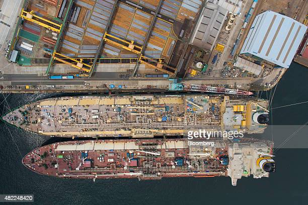 Liquefied natural gas tankers stand under construction in this aerial photograph taken above the Hyundai Heavy Industries Co shipyard in Ulsan South...