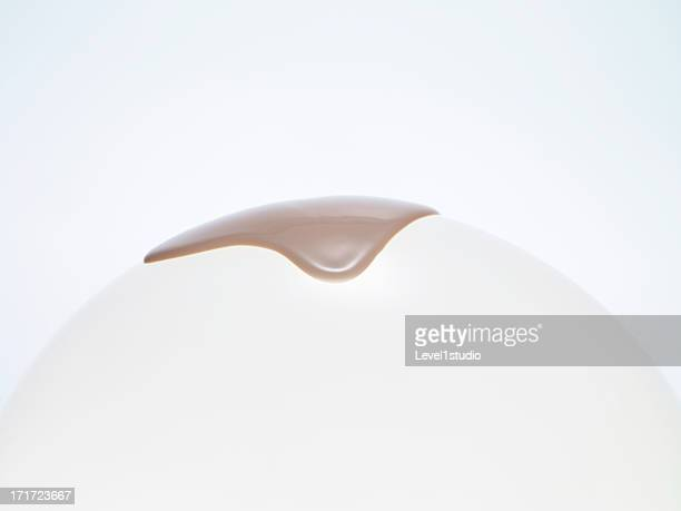 Liquid foundation dropping from spherical surface