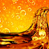 Liquid wave golden, for the project, oil, honey, beer or other variants on oil bubbles  background.