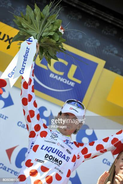 Liquigas's Franco Pellizotti on the podium to collect the polka dot 'King of the Mountains' jersey after the twentieth stage of the Tour de France...