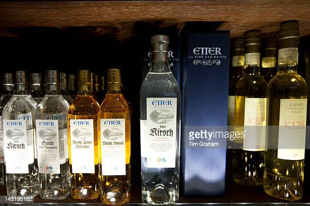 Liquor Etter Eau de Vie and Kirsch on display at Dalmayr food shop and delicatessen in Munich Bavaria Germany