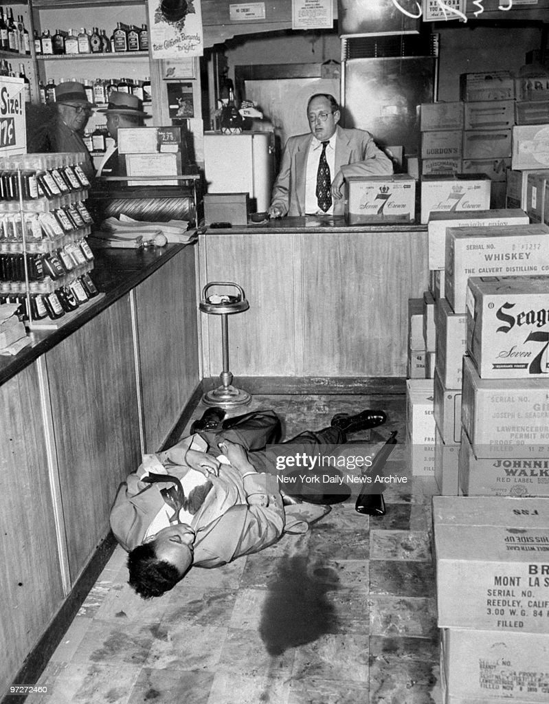 Liquor store owner Abraham Weissman views the body of stickupman, Otis Mims, whom he shot during an attempted robbery.