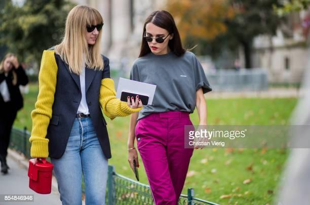 Lisa Aiken and Evangelie Smyrniotaki wearing purple is seen outside Maison Margiela during Paris Fashion Week Spring/Summer 2018 on September 27 2017...