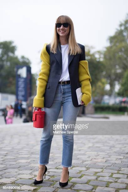 Lisa Aiken is seen attending Maison Margiela during Paris Fashion Week wearing a yellow and navy jacket with jeans on September 27 2017 in Paris...