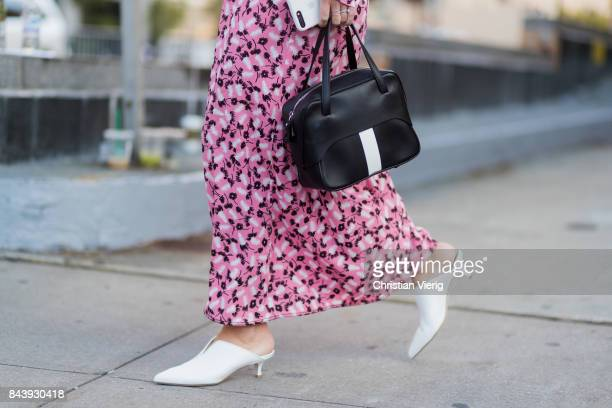 Lisa Aiken seen wearing a pink dress black bag in the streets of Manhattan outside Adam Selman during New York Fashion Week on September 7 2017 in...
