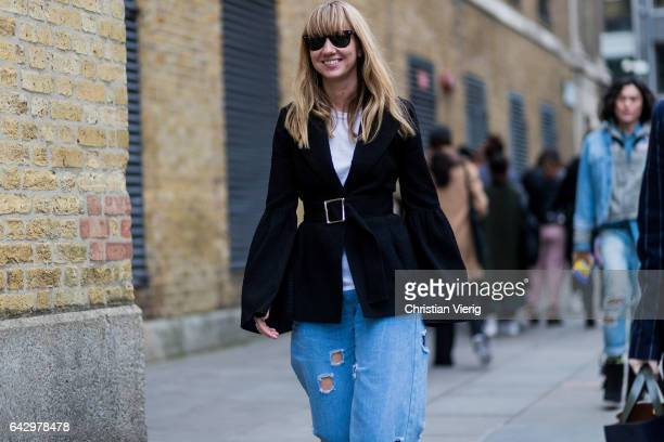Lisa Aiken wearing a belted black jacket outside Mulberry on day 3 of the London Fashion Week February 2017 collections on February 19 2017 in London...