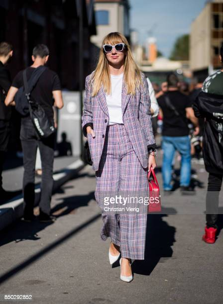 Lisa Aiken wearing a checked grey suit is seen outside Gucci during Milan Fashion Week Spring/Summer 2018 on September 20 2017 in Milan Italy
